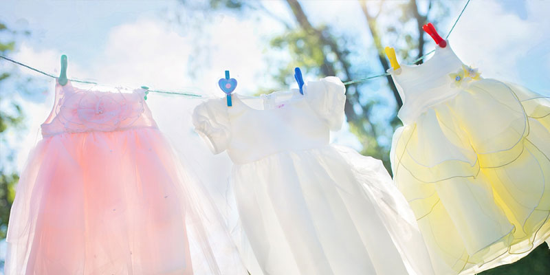 Clean dresses on a washing line